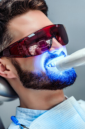 dental laser work in progress on a man's teeth
